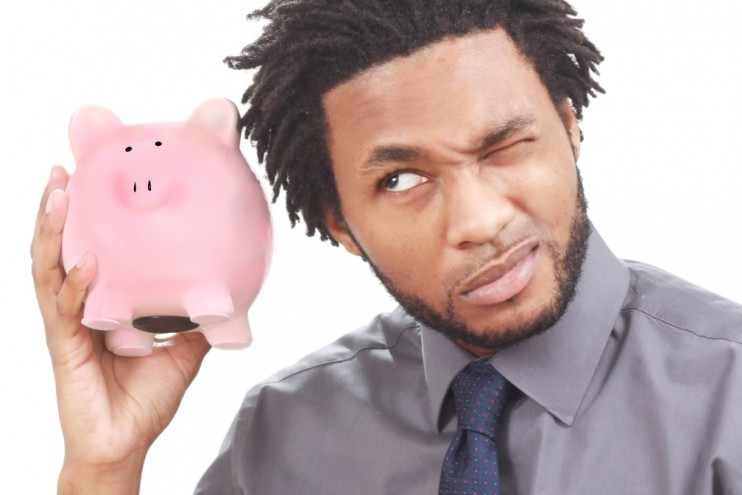 stockvault-man-shaking-a-piggy-bank127892